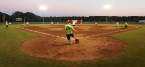 Lauren Wood | Daily Journal Mike Williams on the team Toe Up kicks at the home plate during the kickball game Thursday night against the __ team at the fields in Veterans Park.